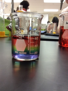 A rainbow forms as sodium carbonate slides to the bottom of the beaker.